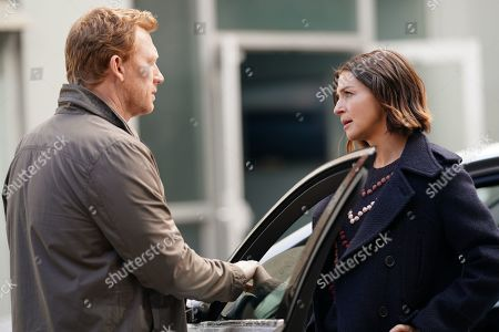Stock Photo of Kevin McKidd as Dr. Owen Hunt and Caterina Scorsone as Dr. Amelia Shepherd