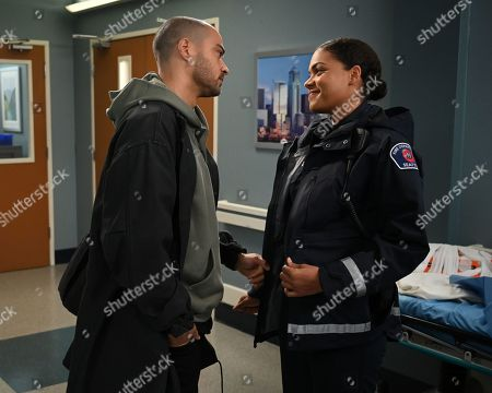 Stock Photo of Jesse Williams as Dr. Jackson Avery and Barrett Doss as Victoria Hughes