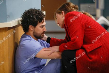Stock Image of Giacomo Gianniotti as Dr. Andrew DeLuca and Ellen Pompeo as Dr. Meredith Grey