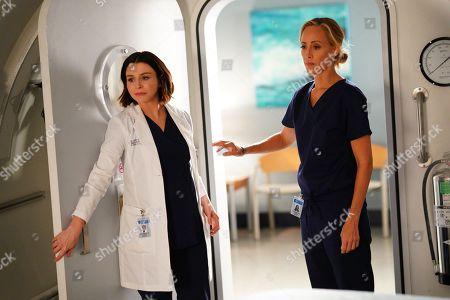 Stock Image of Caterina Scorsone as Dr. Amelia Shepherd and Kim Raver as Dr. Teddy Altman