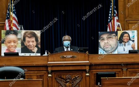Committee Chairman Rep. James Clyburn speaks during a House Select Subcommittee on the Coronavirus Crisis, on Capitol Hill in Washington, . The posters from left show Skylar Herbert, Cheryl Fink Lolley, Jason Hargrove and Demetria Bannister, covid victims who died