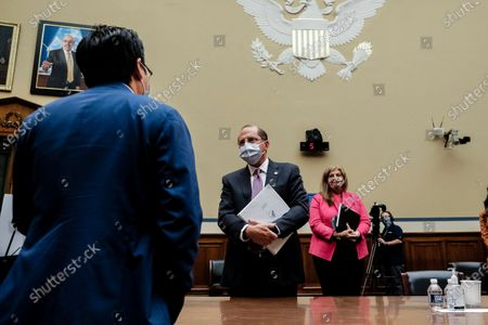 Rep. Andy Kim, D-NJ., left, speaks with Secretary of Health and Human Services Alex Azar after a House Select Subcommittee hearing on the Coronavirus Crisis, on Capitol Hill in Washington