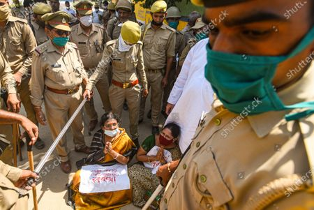 Trinamool Congress MP Pratima Mondal and her colleague protest after they were denied to meet the Hathras gang rape victim's family, on October 2, 2020 in Hathras, India. A four-member delegation of the Trinamool Congress, led by senior party leader Derek O'Brien, was on Friday stopped by the police from going to the village of the 19-year-old gang-rape victim in Hathras of Uttar Pradesh to meet her family.