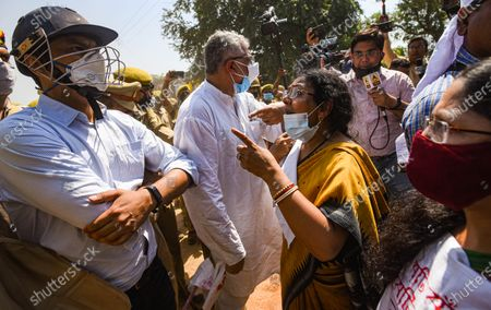Trinamool Congress MP Pratima Mondal speaks to UP police personnel after she and TMC MP Derek O'Brien were manhandled by the police personnel while heading to meet the Hathras gang rape victim's family, on October 2, 2020 in Hathras, India. A four-member delegation of the Trinamool Congress, led by senior party leader Derek O'Brien, was on Friday stopped by the police from going to the village of the 19-year-old gang-rape victim in Hathras of Uttar Pradesh to meet her family.
