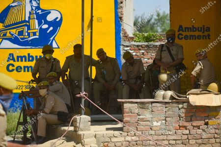 Uttar Pradesh Police personnel deployed at the entrance to Hathras village, on October 2, 2020 in Hathras, India. A four-member delegation of the Trinamool Congress, led by senior party leader Derek O'Brien, was on Friday stopped by the police from going to the village of the 19-year-old gang-rape victim in Hathras of Uttar Pradesh to meet her family.
