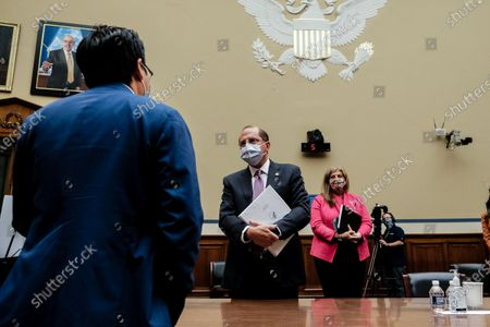Rep. Andy Kim (D-NJ) speaks with Health and Human Services Secretary Alex M. Azar (C) at the conclusion of the House Select Subcommittee on the Coronavirus Crisis in the Rayburn Building in Washington, DC, USA, 02 October 2020. The hearing will examine the impacts of COVID-19 in USA just one day after President Donald Trump and First Lady Melania Trump tested positive for COVID-19.