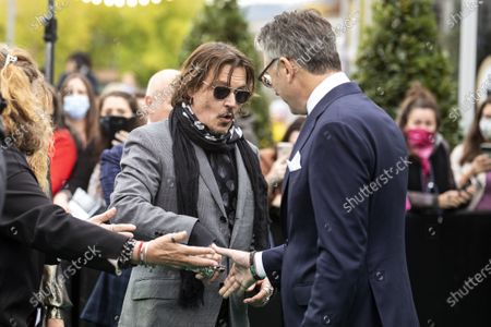 Johnny Depp (L) and Artistic Director Zurich Film Festival Christian Jungen (R) arrive at the 16th Zurich Film Festival (ZFF) in Zurich, Switzerland, 02 October 2020. The festival runs from 24 September to 04 October 2020.