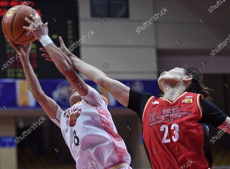 Chen Xinlei (L) of Shaanxi vies with Peng Huaqian of Wuhan SF during 1st round match between Shaanxi and Wuhan SF at the 2020-21 Women's Chinese Basketball Association (WCBA) league in Chengdu, capital of southwest China's Sichuan Province, Oct. 2, 2020.