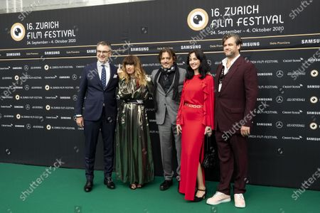 Stock Photo of Christian Jungen, Artistic Director Zurich Film Festival, producer Victoria Mary Clarke, US actor Johnny Depp, Gina Deuters and Stephen Deuters, from left, pose on the Green Carpet during the 16th Zurich Film Festival (ZFF) in Zurich, Switzerland, Friday, October 02, 2020. The festival runs from 24 September to 04October  2020.