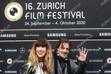 Producer Victoria Mary Clarke and US actor Johnny Depp, from left, pose on the Green Carpet during the 16th Zurich Film Festival (ZFF) in Zurich, Switzerland, Friday, October 02, 2020. The festival runs from 24 September to 04 October 2020.
