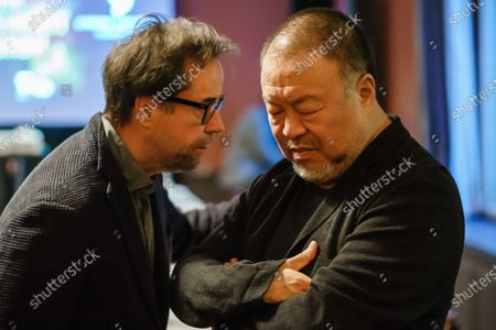 Jan Josef Liefers (L) and Chinese artist Ai Weiwei talk during dinner for the 30th anniversary of the German Reunification at Borchardt restaurant in Berlin, Germany, 02 October 2020. Cinema for Peace foundation invited supporters to announce an artistic memorial in commemoration of former Soviet president Mikhail Gorbachev as one of the acting persons in the German unity.