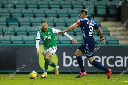 Martin Boyle (#10) of Hibernian on the ball marked by Scott McMann (#3) of Hamilton Academical during the Scottish Premiership match between Hibernian and Hamilton Academical FC at Easter Road, Edinburgh