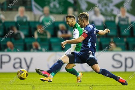 Stock Picture of Scott McMann (#3) of Hamilton Academical stretches to try to block the shot from Martin Boyle (#10) of Hibernian during the Scottish Premiership match between Hibernian and Hamilton Academical FC at Easter Road, Edinburgh