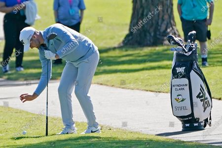 Wyndham Clark takes a drop after hitting into some trees lining the ninth fairway during the second round of the Sanderson Farms Championship golf tournament in Jackson, Miss