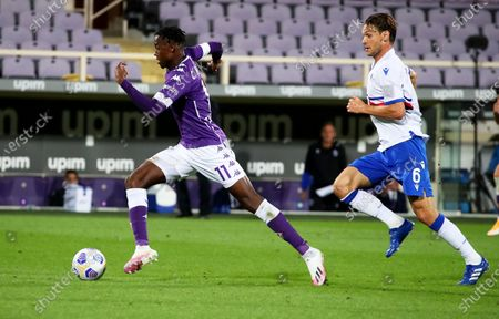 Fiorentina's Christian Kouame (L) in action against Sampdoria's Albin Ekdal (R) during the Italian Serie A soccer match between ACF Fiorentina and UC Sampdoria at the Artemio Franchi stadium in Florence, Italy, 02 October 2020.