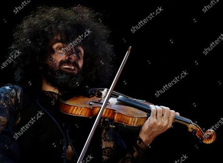 Lebanese violinist Ara Malikian performs on stage at Navarra Arena in Pamplona, northern Spain, 02 October 2020, as part of the Anaim Club Festival.