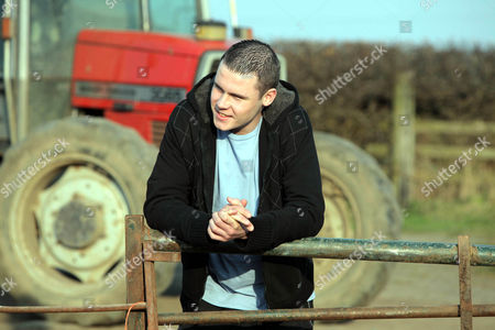 Daz Eden [Luke Tittensor] and Victoria Sugden [Isobel Hodgins] Arrive at the Farm to Find Andy Sugden [Kelvin Fletcher]  Tussling with Aaron Livesy [Danny Miller].  Andy is Shocked When Daz and Victoria Reveal the Truth