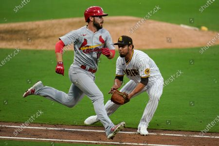 San Diego Padres relief pitcher Luis Patino, right, gets ready to tag out St. Louis Cardinals' Paul DeJong during the sixth inning of Game 3 of a National League wild-card baseball series, in San Diego