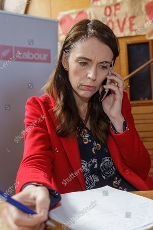 New Zealand Prime Minister Jacinda Ardern speaks to supporters on the phone as she visits a NZ Labour Party South Auckland Get Out The Vote event at Sir Edmund Hillary Collegiate, in Auckland, New Zealand, 03 October 2020. The 2020 New Zealand general election will be held on 17 october 2020.