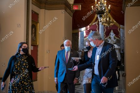 United States House Majority Leader Steny Hoyer (Democrat of Maryland), talks with reporters while making his way the the House floor for a vote, as members of Congress vote on two House resolutions at the US Capitol in Washington, DC.,. The Resolutions are: House Resolution 1153: Condemning unwanted, unnecessary medical procedures on individuals without their full, informed consent and House Resolution 1154: Condemning QAnon and rejecting the conspiracy theories it promotes.