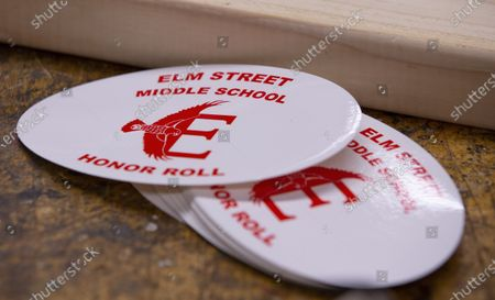 Elm Street Middle School stickers are seen on a work bench in the school's workshop in Nashua, New Hampshire, USA, 02 October 2020. Physical Education teacher John Barry started building the desks after seeing several of his students during online classes, working from kitchen tables, bedroom floors, and even a closet. He and fellow science teacher Dan Scarpeti, found an inexpensive desk plan and started making the desks, and other teachers soon joined in. As of this date, several thousand dollars have been pledged and the group plans to make desks for all students in need.