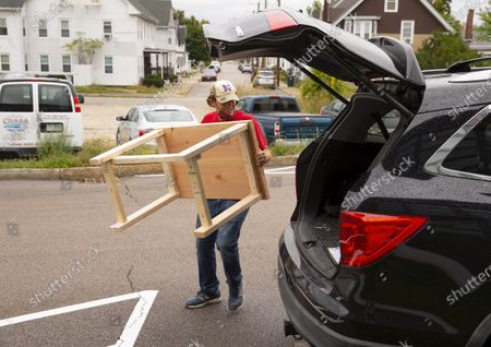 Science teacher Dan Scarpeti loads a desk into his vehicle to deliver it to a student in need at the Elm Street School workshop in Nashua, New Hampshire, USA, 02 October 2020. Physical Education teacher John Barry started building the desks after seeing several of his students during online classes, working from kitchen tables, bedroom floors, and even a closet. He and fellow science teacher Dan Scarpeti, found an inexpensive desk plan and started making the desks, and other teachers soon joined in. As of this date, several thousand dollars have been pledged and the group plans to make desks for all students in need.