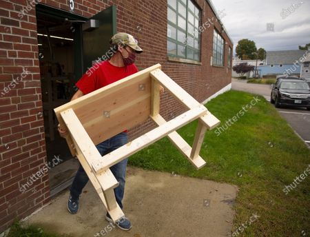 Editorial picture of Teachers build desks for home-learning students in need amid pandemic, Nashua, USA - 02 Oct 2020