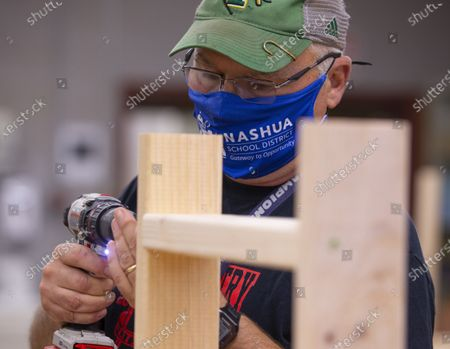 Editorial photo of Teachers build desks for home-learning students in need amid pandemic, Nashua, USA - 02 Oct 2020
