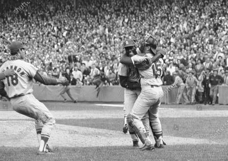 St. Louis Cardinals pitcher Bob Gibson receives a congratulatory hug from catcher Tim McCarver after he pitched a three-hitter in the team's 7-2 victory in Game 7 over the Boston Red Sox to win the World Series at Fenway Park in Boston, Mass. At left is third baseman Mike Shannon. Gibson, the dominating pitcher who won a record seven consecutive World Series starts and set a modern standard for excellence when he finished the 1968 season with a 1.12 ERA, died . He was 84