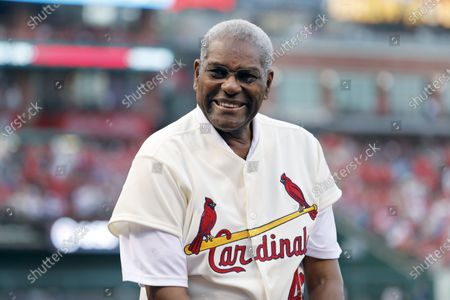 Stock Photo of Bob Gibson, a member of the St. Louis Cardinals' 1967 World Series championship team, takes part in a ceremony honoring the 50th anniversary of the victory, before a baseball game between the Cardinals and the Boston Red Sox in St. Louis. Gibson, the dominating pitcher who won a record seven consecutive World Series starts and set a modern standard for excellence when he finished the 1968 season with a 1.12 ERA, died . He was 84