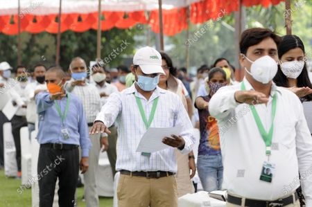 Noida Authority officials and locals take an oath keep the city clean and green during a programme held at Indira Gandhi Kala Kendra, in Noida Sector -6, on October 2, 2020 in Noida, India.