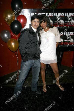 Stock Image of Paul Cruz and Geretta-Geretta.