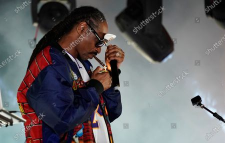 """Snoop Dogg performs a DJ set as """"DJ Snoopadelic"""" during the """"Concerts In Your Car"""" series at the Ventura County Fairgrounds, in Ventura, Calif"""