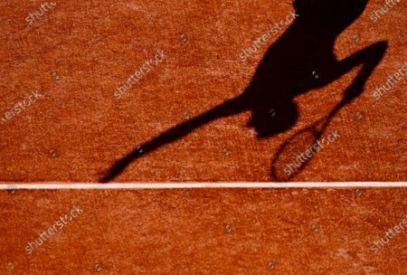 Roberto Bautista Agut casts a shadow as he serves during his third round match