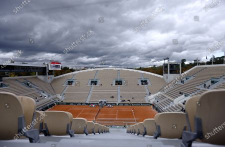 Clouds move in over Court Suzanne-Lenglen during the third round match between Spanish players Roberto Bautista Agut and Pablo Carreno Busta at the French Open tennis tournament at Roland Garros in Paris, France, 03 October 2020.