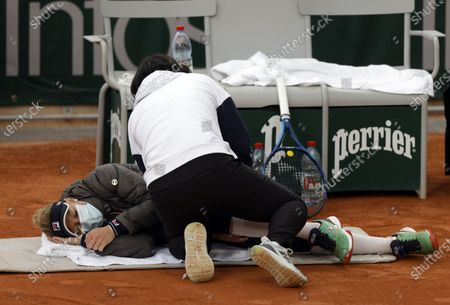 Laura Siegemund of Germany gets medical assistance as she plays Petra Martic of Croatia during their women's third round match during the French Open tennis tournament at Roland Garros in Paris, France, 03 October 2020.
