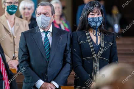 Gerhard Schroeder, former German Chancellor, and his wife Schroeder-Kim So-yeon attend an ecumenical church service at Saint Peter and Paul church during German Unity Day in Potsdam, Germany, 03 October 2020.