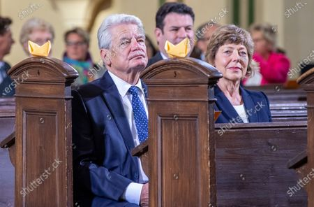 Joachim Gauck, former German President, and Daniela Schadt attend an ecumenical church service at Saint Peter and Paul church during German Unity Day in Potsdam, Germany, 03 October 2020.