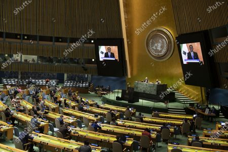 Equatorial Guinean President Teodoro Obiang Nguema Mbasogo (on the screens) addresses a high-level UN meeting to mark the International Day for the Total Elimination of Nuclear Weapons at the UN headquarters in New York, on Oct. 2, 2020.