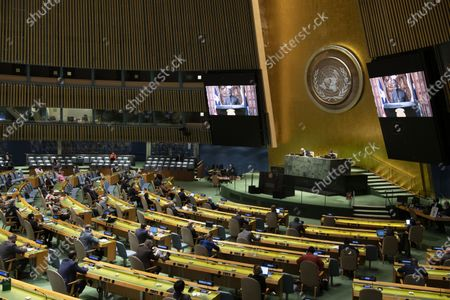 Liberian President George Weah (on the screens) addresses a high-level UN meeting to mark the International Day for the Total Elimination of Nuclear Weapons at the UN headquarters in New York, on Oct. 2, 2020.