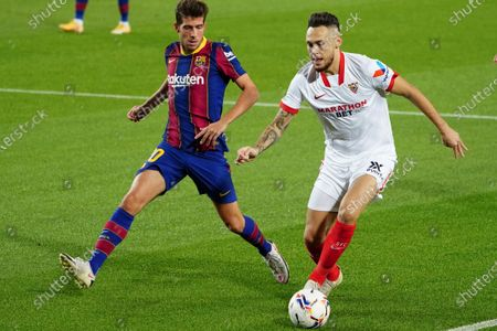 Ocampos holds the ball away from Sergi Roberto of Barca; Camp Nou, Barcelona, Catalonia, Spain; La Liga Football, Barcelona versus Sevilla.