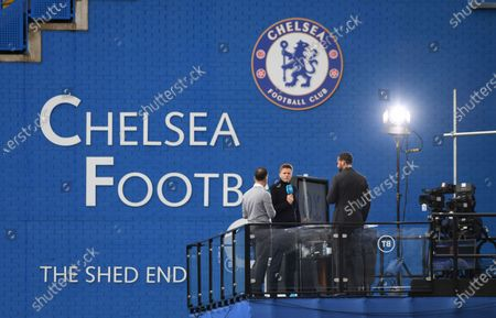 BT Sport Presenter Jake Humphrey (C)  former Chelsea player Joe Cole (L) and former Manchester United player Rio Ferdinand (R) converse before the English Premier League match between Chelsea and Crystal Palace in London, Britain, 03 October 2020.
