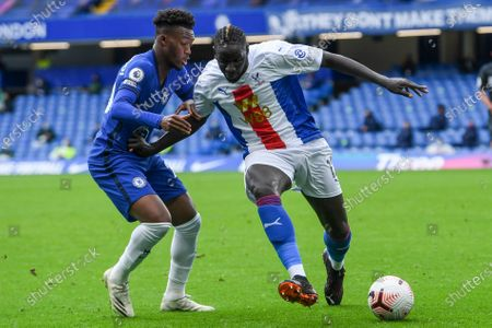 Chelsea's Callum Hudson-Odoi, left, and Crystal Palace's Mamadou Sakho fight for the ball during an English Premier League soccer match between Chelsea and Crystal Palace at Stamford Bridge stadium in London
