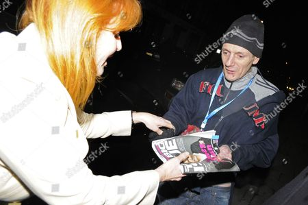 Sarah Ferguson, Duchess of York  buying a copy of the Big Isuue from a vendor