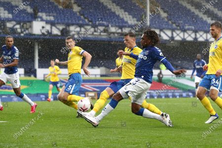 Everton's Alex Iwobi crosses the ball for the third goal during the English Premier League soccer match between Everton and Brighton at the Goodison Park stadium in Liverpool, England