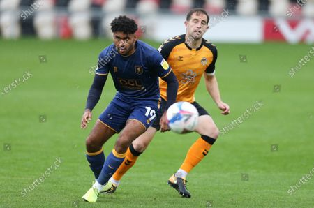 Stock Image of Jamie Reid of Mansfield Town and Matty Dolan of Newport County compete for the ball