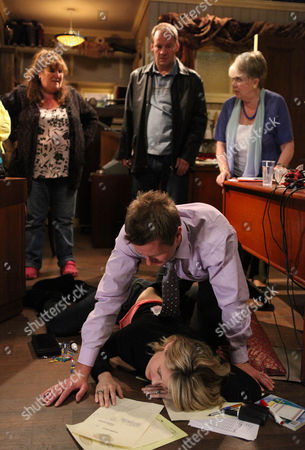 Gennie Walker [Sian Reese Williams] Goes into the Factory Office and Finds Lexi Nicholls [Sally Oliver]  Has Collapsed. Lisa Dingle [Jane Cox] Phones for an Ambulance. Carl King [Tom Lister] Arrives.