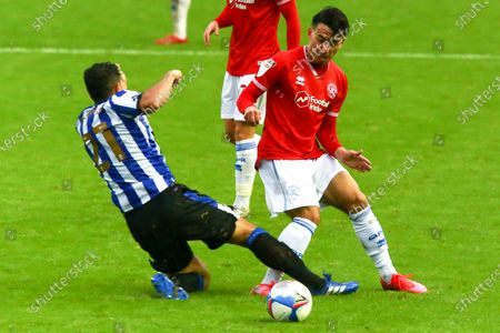 Massimo Luongo of Sheffield Wednesday slide tackles Ilias Chair of Queens Park Rangers