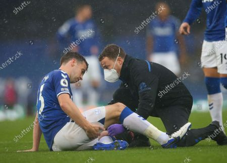 Seamus Coleman of Everton receives medical treatment during the English Premier League match between Everton and Brighton in Liverpool, Britain, 03 October 2020.