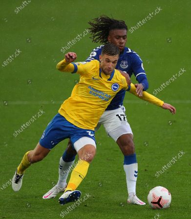 Alex Iwobi of Everton (R) in action against Joel Veltman of Brighton (L) during the English Premier League match between Everton and Brighton in Liverpool, Britain, 03 October 2020.